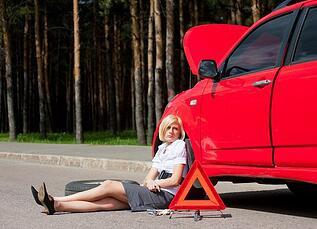 woman and broken red car   fertility wellness self care metaphor
